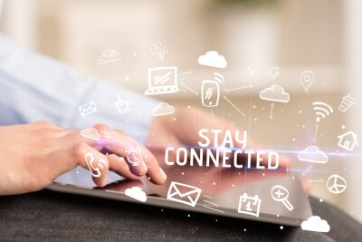 Close-up Of A Person Using Social Networking with STAY CONNECTED inscription
