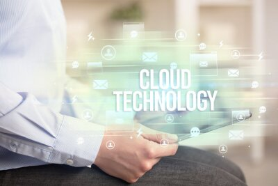 Close-up of a tablet searching CLOUD TECHNOLOGY inscription, modern technology concept