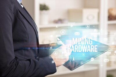 Close-up of a tablet searching MINING HARDWARE inscription, modern technology concept