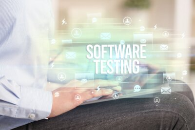 Close-up of a tablet searching SOFTWARE TESTING inscription, modern technology concept