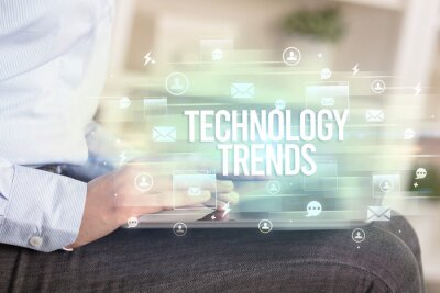 Close-up of a tablet searching TECHNOLOGY TRENDS inscription, modern technology concept
