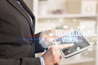 Close-up of a tablet searching TECHNOLOGY VISION inscription, modern technology concept