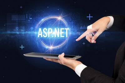 Close-up of a touchscreen with ASP.NET inscription, new technology concept
