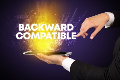 Close-up of a touchscreen with BACKWARD COMPATIBLE inscription, innovative technology concept