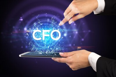 Close-up of a touchscreen with CFO abbreviation, modern technology concept