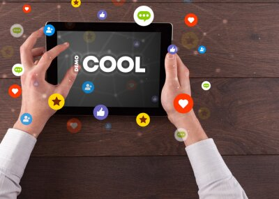 Close-up of a touchscreen with #COOL inscription, social networking concept