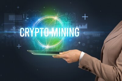 Close-up of a touchscreen with CRYPTO MINING inscription, new technology concept