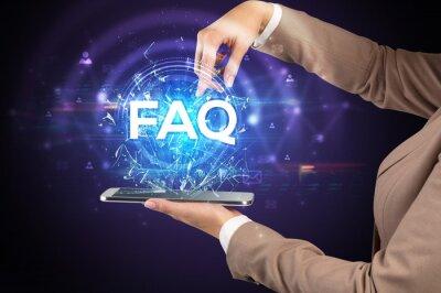 Close-up of a touchscreen with FAQ abbreviation, modern technology concept