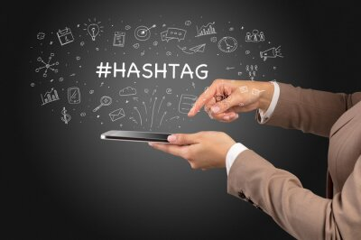 Close-up of a touchscreen with #HASHTAG inscription, social media concept
