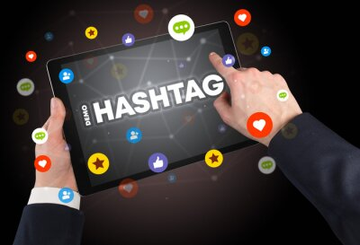 Close-up of a touchscreen with #HASHTAG inscription, social networking concept