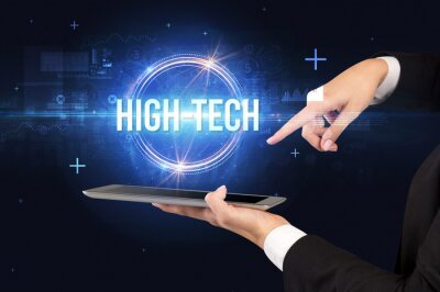 Close-up of a touchscreen with HIGH-TECH inscription, new technology concept