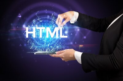 Close-up of a touchscreen with HTML abbreviation, modern technology concept