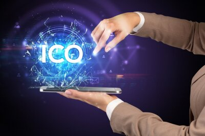 Close-up of a touchscreen with ICO abbreviation, modern technology concept
