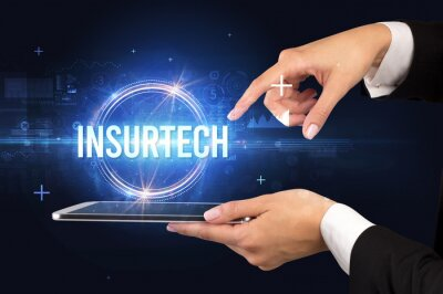Close-up of a touchscreen with INSURTECH inscription, new technology concept