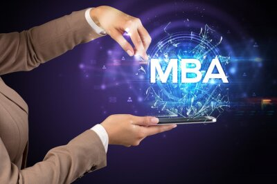 Close-up of a touchscreen with MBA abbreviation, modern technology concept