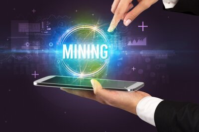 Close-up of a touchscreen with MINING inscription, new technology concept