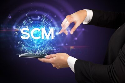 Close-up of a touchscreen with SCM abbreviation, modern technology concept