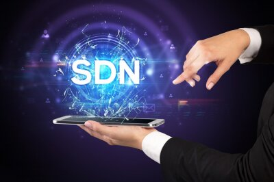 Close-up of a touchscreen with SDN abbreviation, modern technology concept
