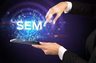 Close-up of a touchscreen with SEM abbreviation, modern technology concept