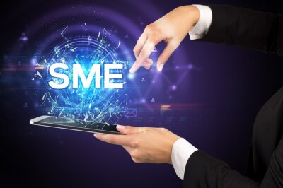 Close-up of a touchscreen with SME abbreviation, modern technology concept