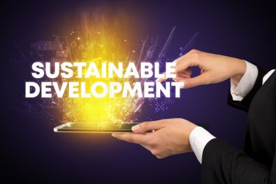 Close-up of a touchscreen with SUSTAINABLE DEVELOPMENT inscription, innovative technology concept