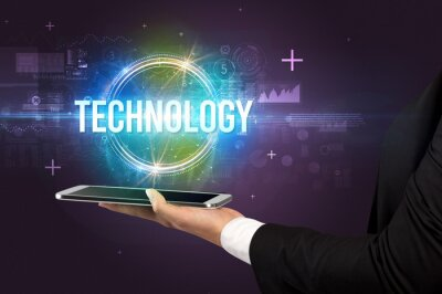 Close-up of a touchscreen with TECHNOLOGY inscription, new technology concept