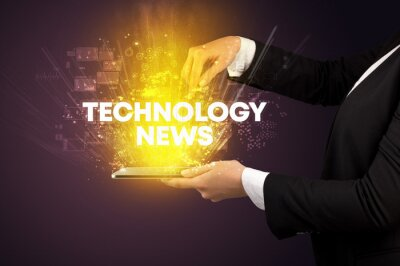 Close-up of a touchscreen with TECHNOLOGY NEWS inscription, innovative technology concept