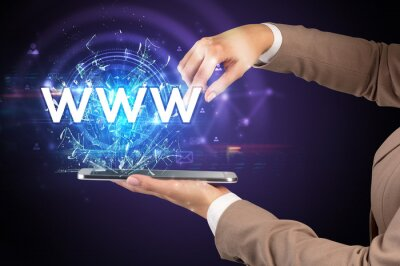 Close-up of a touchscreen with WWW abbreviation, modern technology concept