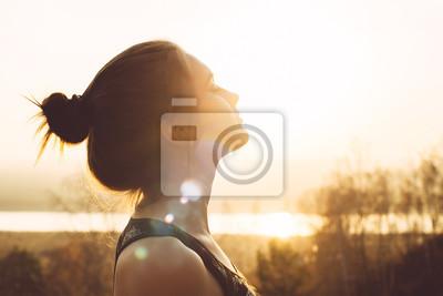 Bild Close-up portrait of a pretty young woman in the sun