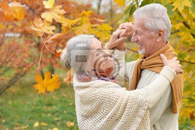 Bild Close up portrait of happy senior couple in autumn park