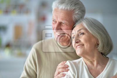 Bild Close up portrait of happy senior couple posing