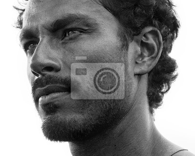 Bild Close up portrait of healthy man with black hair, strong features, looking straight ahead at a three quarters angle, black and white