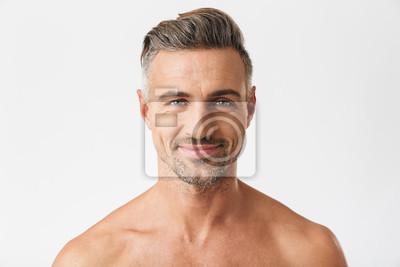 Bild Closeup portrait of european half naked man 30s having bristle smiling at camera