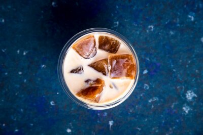 Bild Cold summer refreshing drink with coffee ice and milk on a blue table