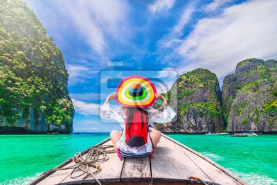 Bild Colorful summer lifestyle traveler woman joy fun relaxing on boat at sunny beach Maya bay Krabi, Tourist girl on holiday vacation trip, Travel Phuket Thailand, Tourism beautiful destination place Asia