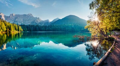 Bild Colorful summer view of Fusine lake. Bright morning scene of Julian Alps with Mangart peak on background, Province of Udine, Italy, Europe. Traveling concept background.