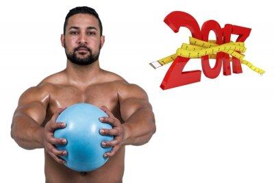 Composite-Bild der muskulösen Mann Ausarbeitung mit Gewicht
