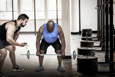 Composite-Bild von Menschen hob barbell mit Trainer