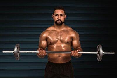 Composite-Bild von Muskel Mann hebt schwere Langhantel