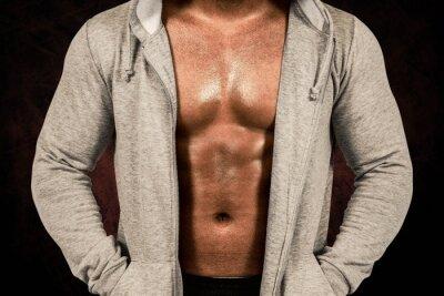 Composite-Bild von muskulösen Mann in Kapuze Pullover