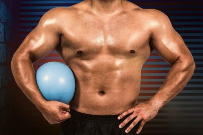 Composite image of muscular man with weight ball