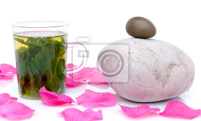 Bild Composition with a cup of mint tea, pebbles and pink petals