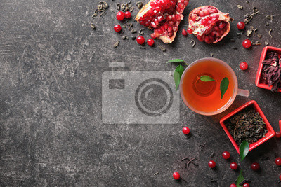 Bild Composition with glass cup of hot aromatic tea on table
