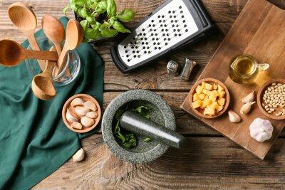 Bild Composition with tasty pesto sauce on wooden background