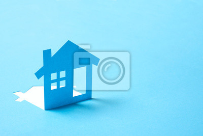 Bild Concept of house in paper on blue color background for real estate property industry