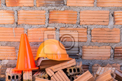 Bild construction helmet safety and cone in construction site