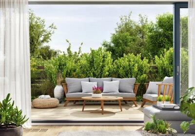Bild Cozy patio area with garden furniture, sliding doors and decking