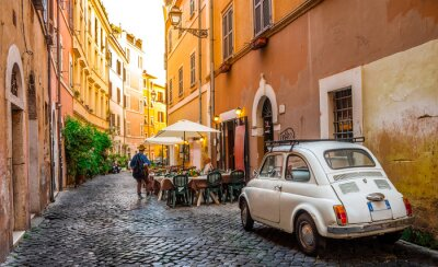 Bild Cozy street in Trastevere, Rome, Europe. Trastevere is a romantic district of Rome, along the Tiber in Rome. Turistic attraction of Rome.