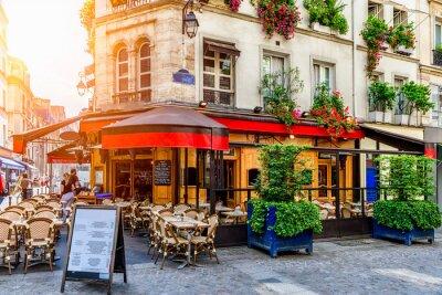 Bild Cozy street with tables of cafe in Paris, France. Architecture and landmark of Paris. Cozy Paris cityscape.