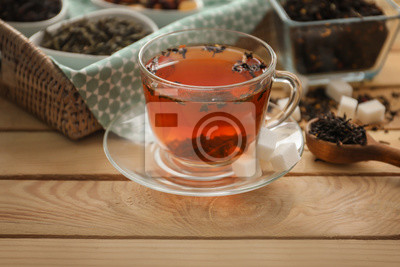 Bild Cup of hot aromatic tea on wooden table